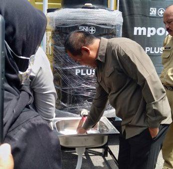Penyerahan Bantuan 30 Unit Tangki Air Oleh PT Bangun Indopralon