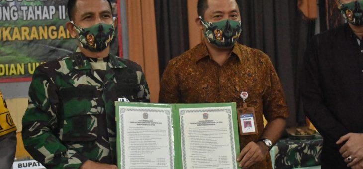 Penandatanganan Naskah Berita Acara Penyerahan Program TMMD Sengkuyung II
